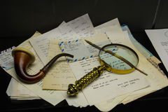 Sherlock Holmes pipe and letters Royalty Free Stock Photos