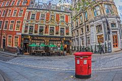 Sherlock Holmes Pub and typical old red british mailbox Stock Photos