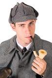 Sherlock: Man med allvarlig blick och röret royaltyfri bild