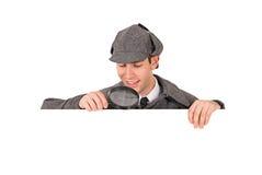 Sherlock: Vista para baixo em Whitespace com lente de aumento imagem de stock royalty free
