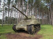 Sherman Tank. Vintage sherman tank resting in a peaceful forest Royalty Free Stock Image
