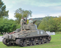 Sherman tank in historical reenactment of WWII. Old Sherman tank and American men dressed up as American troops in historical reenactment of WWII in Austin,Texas Stock Photography