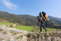 Sherpa carry heavy load Stock Photo