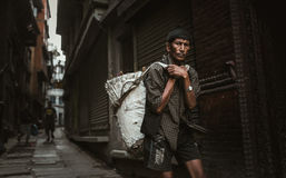 Sherpa carrying a weight in Nepal Stock Images
