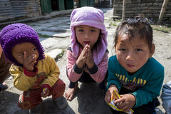 Sherpa children play in their village. ANNAPURNA, NEPAL, MARCH 19: Sherpa children play in their village in Annapurna, Nepal, March 19, 2012. Sherpa are an Royalty Free Stock Image