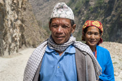 Sherpa couple are going to local market. ANNAPURNA, NEPAL, MARCH 19: Sherpa couple are going to local market in Annapurna, Nepal, March 19, 2012. Sherpa are an Stock Photography