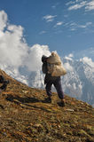 Sherpa in Himalayas. Sherpa in picturesque Himalayas mountains in Nepal Stock Photos