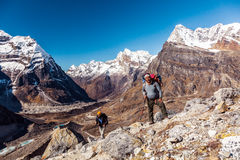 Sherpa Mountain Guide and his Client on Mountain Footpath Stock Photo