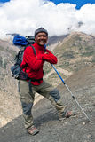Sherpa Trekking guide, Nepal. UPPER DOLPO, NEPAL - SEPTEMBER 16: Sherpa trekking guide walking to the pass on September 16, 2011 in Upper Dolpo restricted area Royalty Free Stock Images