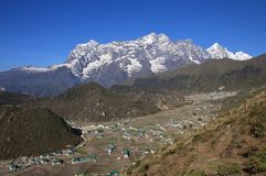 Sherpa village Khumjung and high mountains. Spring scene in the Everest National Park, Nepal Royalty Free Stock Image