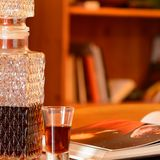 Sherry, decanter and book Royalty Free Stock Photo
