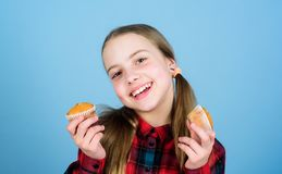 Shes so sweet that makes the food taste good. Small girl smiling with freshly baked dessert food. Happy little child royalty free stock images