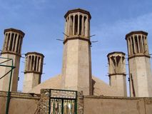 Shesh Badgiri in Yazd, Iran. Yazd, Iran - March 21, 2010: Famous Shesh Badgiri water reservoir with six wind-catcher towers in central Yazd Stock Image
