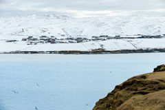 Shetland Islands. Seascape, snow covered remote village Stock Photography