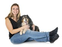 Shetland Sheepdog and woman. In front of white background royalty free stock photography