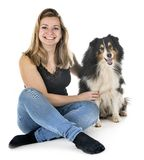 Shetland Sheepdog and woman. In front of white background stock images