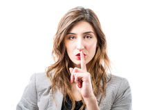 Shh. Finger on lips. Stock Images