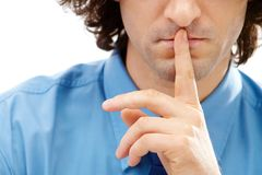 Shhh. Image of gesture: male finger over lips Stock Photos