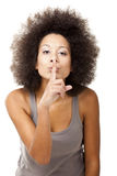 Shhh, Silence... Beautiful Afro-American woman doing a silence gesture with her hand, isolated on white royalty free stock photography