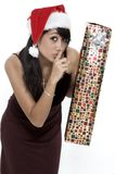 Shhhh!. Cute Girl About To Surpise Someone with A Present royalty free stock image