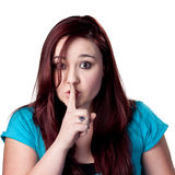 SHHHH Be Quiet!. Fingers on lips, woman tells people to be quiet Stock Image