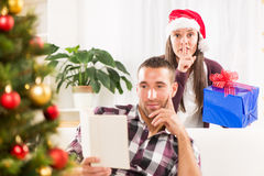 Shhhh, I have a Christmas gift for him Stock Photo