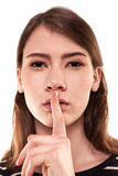 Shhhhh kvinna! Finger på kanter Tyst - tystnadmaterielbild Arkivbilder