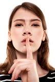 Shhhhh kvinna! Finger på kanter Tyst - tystnadmaterielbild Arkivfoto
