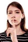 Shhhhh kvinna! Finger på kanter Tyst - tystnadmaterielbild Royaltyfri Foto