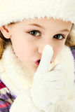 Shhhhh Quiet Girl Keeping Secret. Beautiful seven year old girl dressed for winter with hat and gloves and scarf making quiet or secret gesture with hands stock image