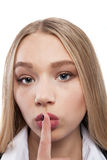 Shhhhh - young beautiful woman finger on lips - Stock Image Stock Photos