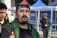 Shia Muslim men shout Islamic slogans Ashura procession Royalty Free Stock Image