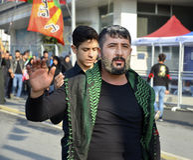 Shia Muslim men shout Islamic slogans Ashura procession Stock Photography