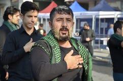 Shia Muslim men shout Islamic slogans Ashura procession Royalty Free Stock Images