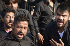 Shia Muslim men shout Islamic slogans Ashura procession Royalty Free Stock Photos
