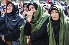 Shia Muslim women mourn during an Ashura Stock Photos