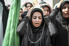 Shia Muslim women shout Islamic slogans Ashura procession. Istanbul, Turkey - October 11, 2016: Shia Muslim women shout Islamic slogans as they mourn during an Royalty Free Stock Photo