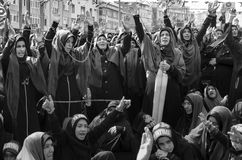 Shia Muslim women shout Islamic slogans Ashura procession. Istanbul, Turkey - October 11, 2016: Shia Muslim women shout Islamic slogans as they mourn during an Stock Image