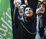 Shia Muslim women shout Islamic slogans Ashura procession. Istanbul, Turkey - October 11, 2016: Shia Muslim women shout Islamic slogans as they mourn during an Royalty Free Stock Photos