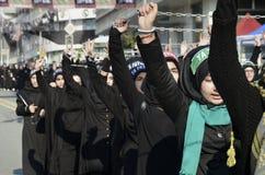 Shia Muslim women shout Islamic slogans Ashura procession. Istanbul, Turkey - October 11, 2016: Shia Muslim women shout Islamic slogans as they mourn during an Stock Photos