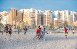 SHIBAM, YEMEN - February, 21: Yemeni boys playing soccer at Shib Stock Image