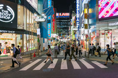 Shibuya district of Tokyo in evening with people on streets Royalty Free Stock Photo