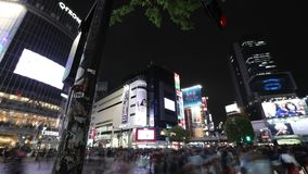 Shibuya night time lapse. Tokyo, Japan - April 22, 2017: night time lapse of unidentified pedestrians in Shibuya Crossing, one of the busiest crosswalks in the stock video