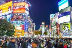 Shibuya scramble crossing in Tokyo at night, Japan Stock Images