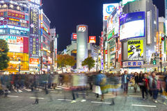 Shibuya scramble crossing in Tokyo at night, Japan. TOKYO, JAPAN - NOVEMBER 12, 2016: Shibuya scramble crossing in Tokyo at night, Japan. Shibuya Crossing is one Royalty Free Stock Photo