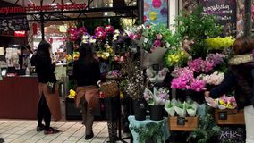 Shibuya Station in Tokyo. People sell flowers at Shibuya Station in Tokyo. It is the world's busiest transport hub with daily usage by up to 3.64 million people stock video