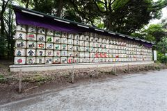 Barrels of Sake are stacked at the entrance to the meiji jingo shrine in Tokyo, Japan Royalty Free Stock Image