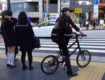 Shibuya Tokyo girl bicycle. People at the street cross near Shibuya station, Tokyo, Japan Royalty Free Stock Photos