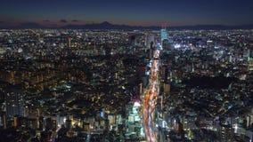 Shibuya Tokyo and Mount Fuji it dusk time-lapse 4K. Shibuya Tokyo and Mount Fuji it dusk time-lapse with traffic 4K stock video