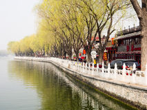 Shichahai lakes, Beijing. Beijing, China - March 26, 2015: Lakeside promenade in old Shichahai district Royalty Free Stock Photography